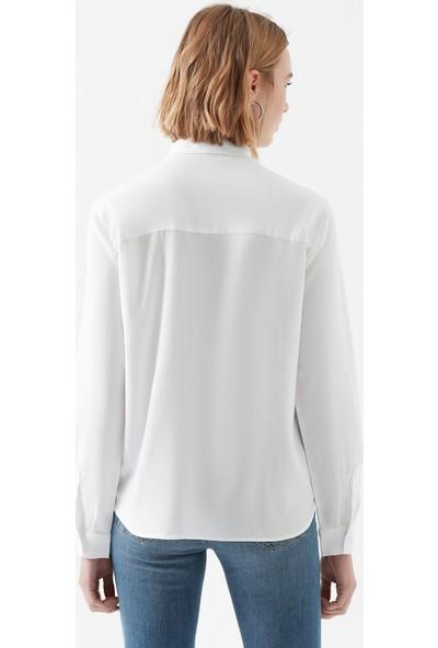 Mavi Cepli Beyaz Gömlek
