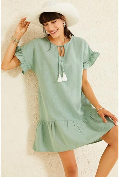 Oshebu Etek Ucu Volanlı Yakası Bağcıklı Keten Elbise