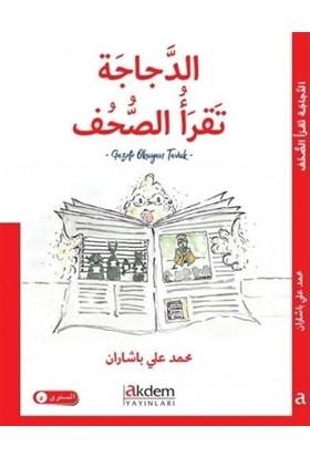 Gazete Okuyan Tavuk (Arapça)