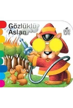 Gözlüklü Aslan - Delikli Kitaplar Serisi